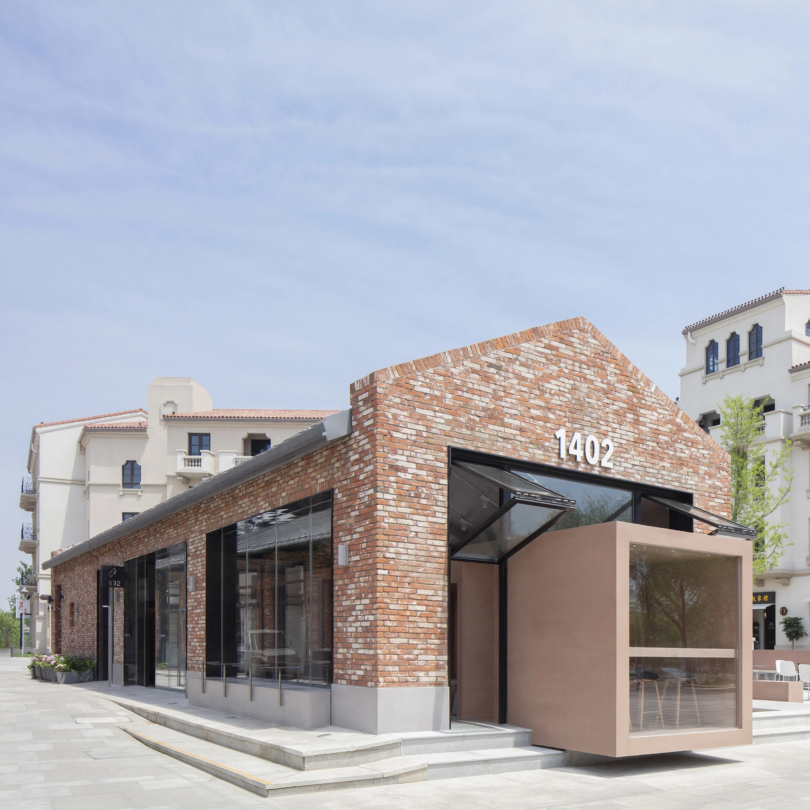 BLUE Architecture adds rectangular coffee shop to red brick building in China